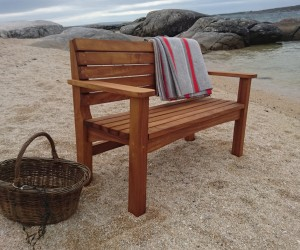 Solid teak outdoor seat, designed to endure life in the elements.